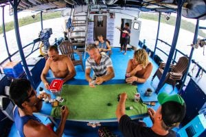 seriti back deck passengers playing cards surf banyak
