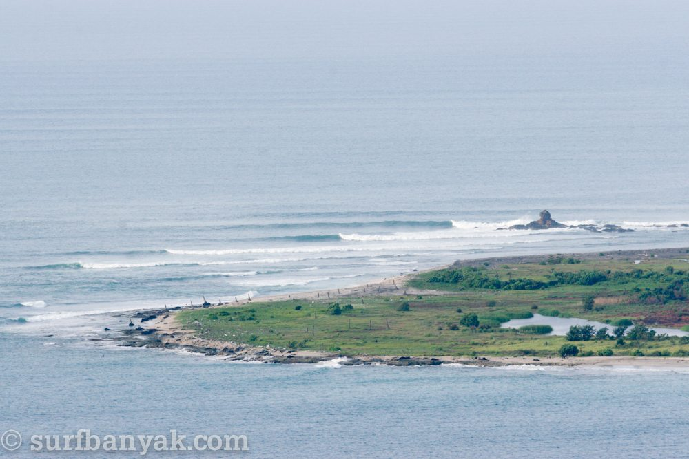 aerial view of surging waves, surf banyak