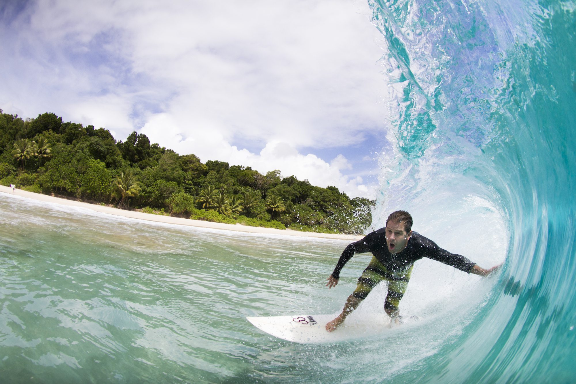 surfer in a perfect hollow waves, surf banyak