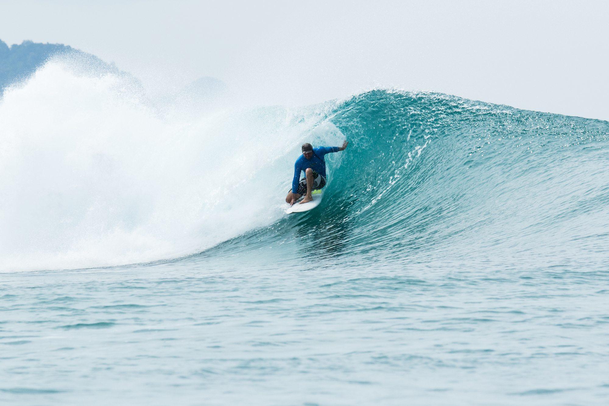surfer in spilling wave, surf banyak