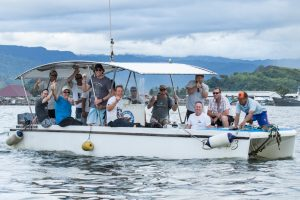 powercat boat with a group of people having fun by surf banyak