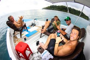 group of men in powercat having a drinks by surf banyak