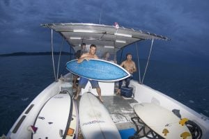 powercat with lots of surfing boards by surf banyak