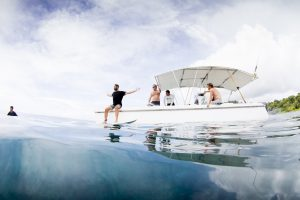 men in powercat is going to have a dip in the sea by surf banyak