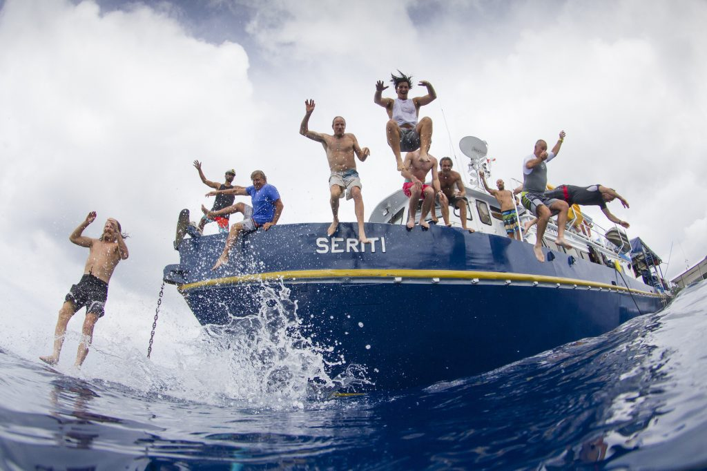 surf, Surf charters, seriti passengers jumping and enjoying to the water of surf banyak