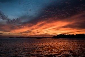 a beautiful sunset by surf banyak