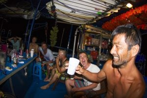 group of men is having fun and drinks in seriti by surf banyak