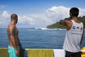 two men does wave watching by surf banyak