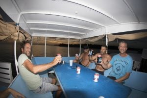 seriti top deck passengers having fun by surf banyak