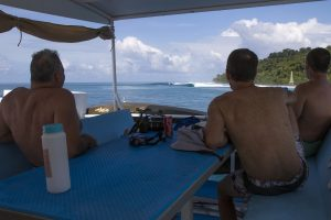 seriti top deck and three passengers relaxing and watching some waves by surf banyak