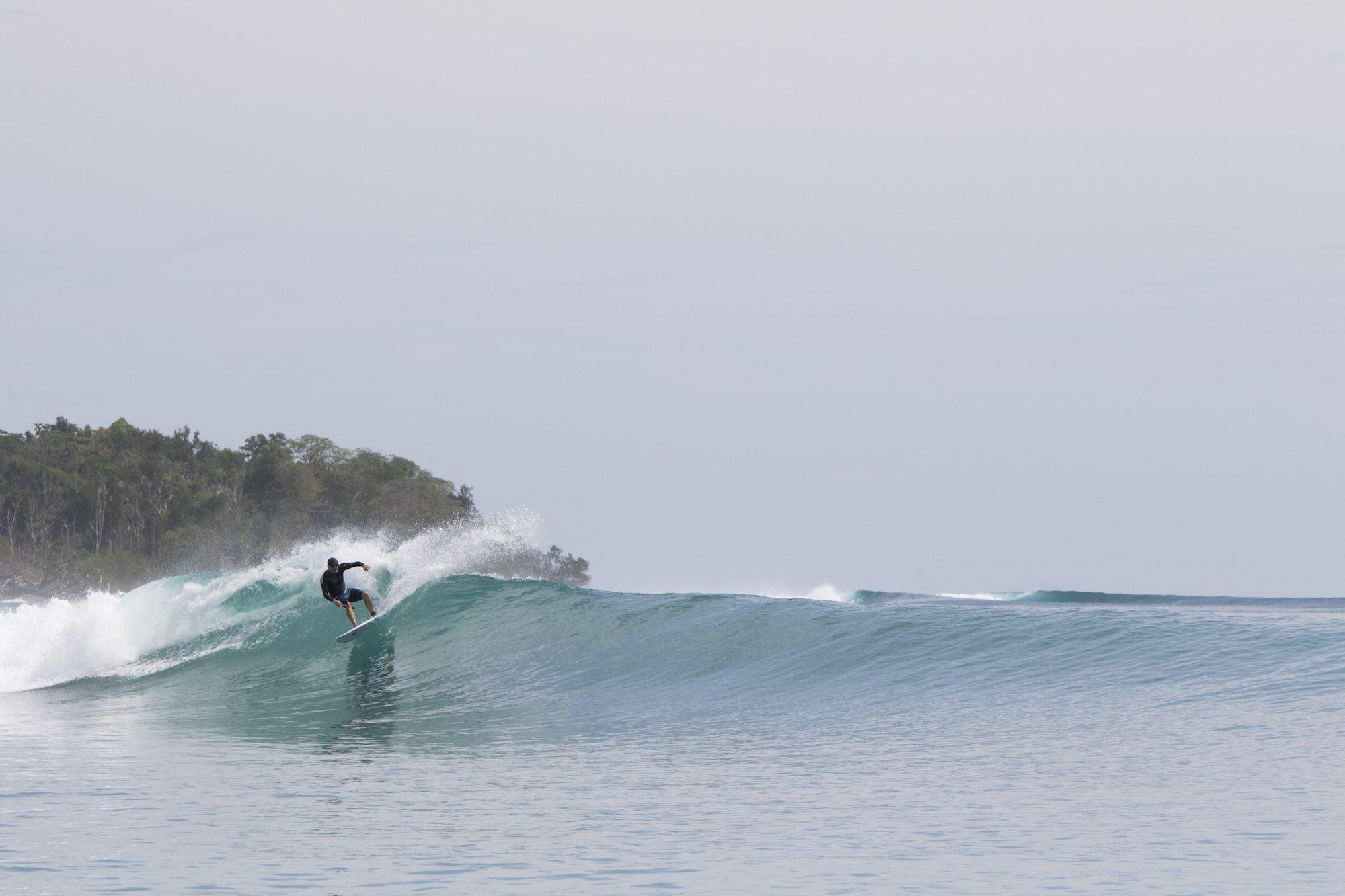 surfer surfing by surf banyak