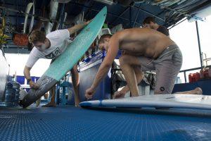 seriti passengers waxing and preparing surfing by surf banyak