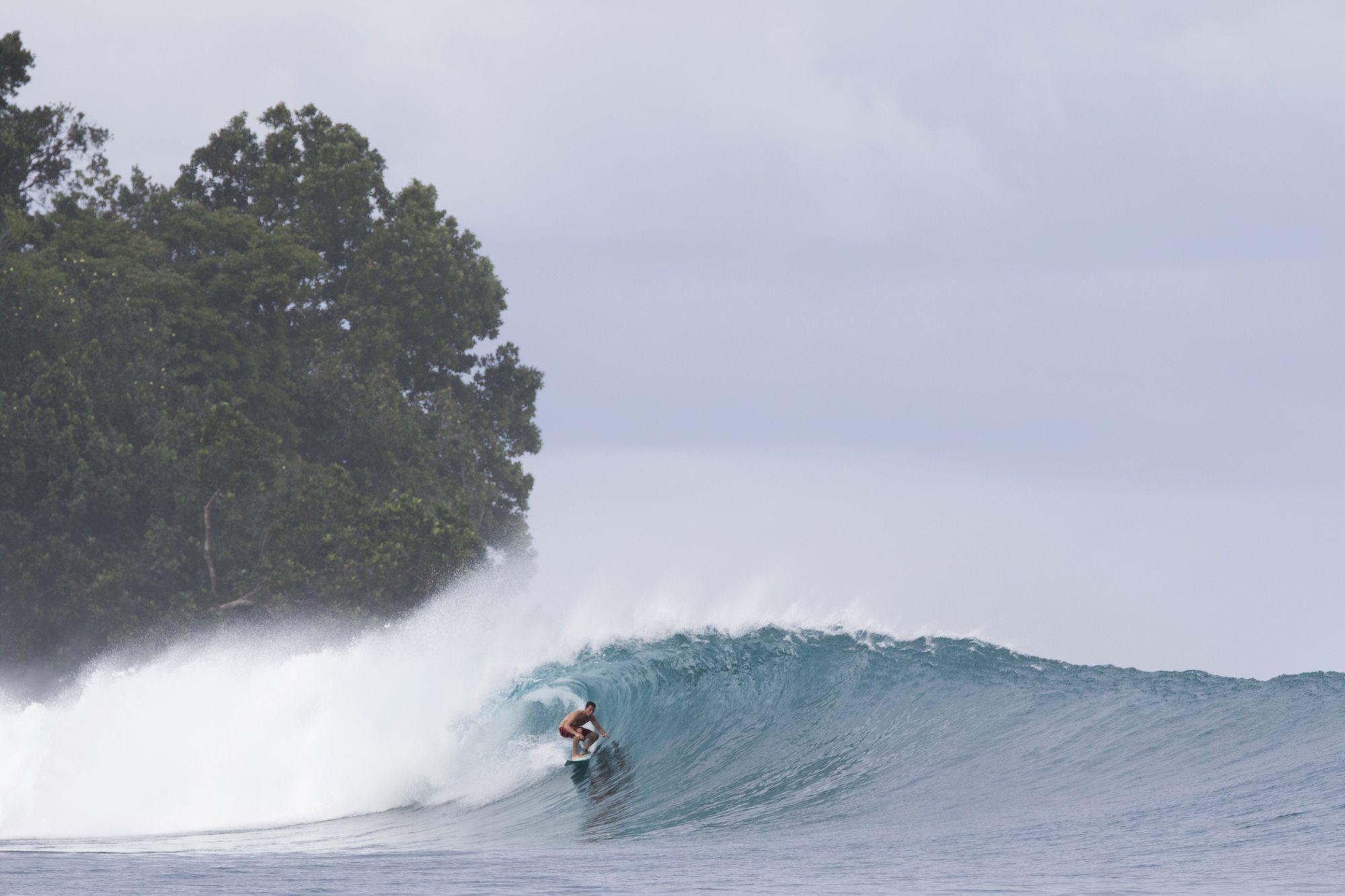 surfer in mini hollow wave, surf banyak
