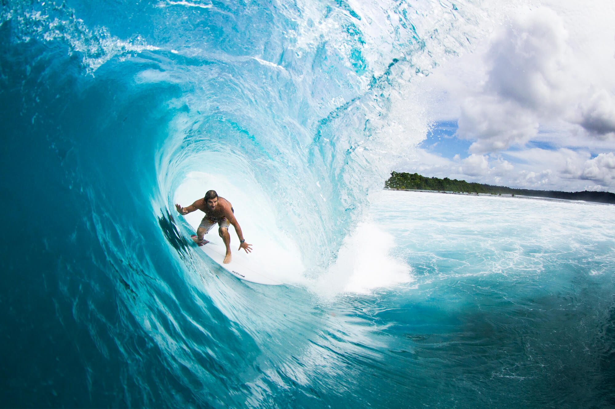 a surfer in drift surfing perfectly got the wave at surf banyak